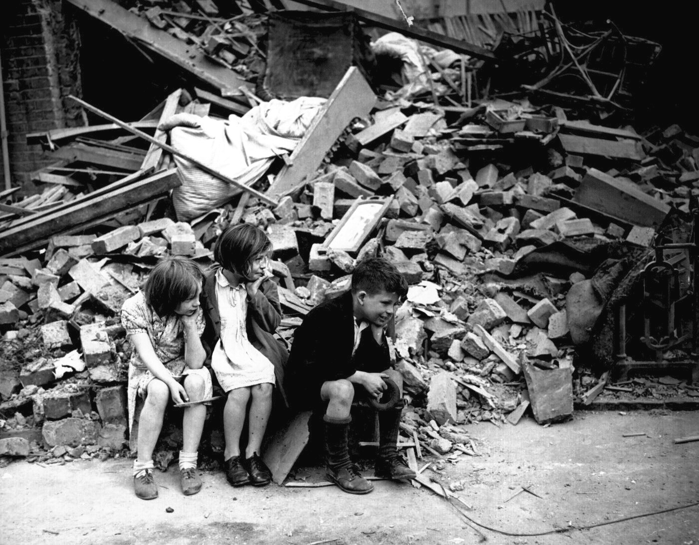 Three Children Sit In Front Of A Pile Rubble Who Are They Related Where Their Parents What Was The Building Before It Destroyed